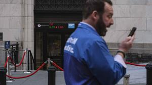 A market trader talks on his phone in front of New York Stock Exchange, Monday, March 9, 2020, in New York.Stocks went into a steep slide Monday on Wall Street as coronavirus fears and a crash in oil prices spread alarm through the market, triggering the first automatic trading halt in over two decades. (AP Photo/Yuki Iwamura)