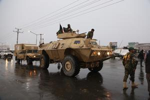An Afghan official and an eyewitness say blasts have been heard and a gun battle took place (Rahmat Gul/AP)
