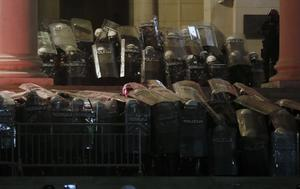 Serbian riot police guard the parliament building during the latest protest (Darko Vojinovic/AP)