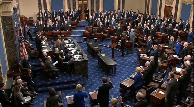 Supreme Court Chief Justice John Roberts swears in members of the Senate (Senate Television/AP)
