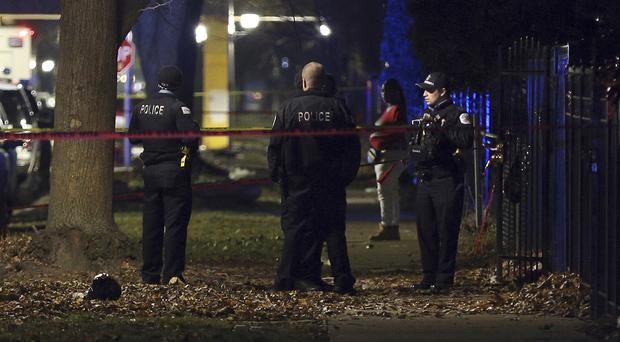 Police at the scene of the shooting in Chicago (Terrence Antonio James/Chicago Tribune via AP)