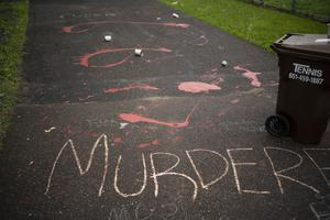 Splattered paint and chalk writing are on the driveway of the home of fired Minneapolis police Officer Derek Chauvin (Jeff Wheeler/Star Tribune/AP)
