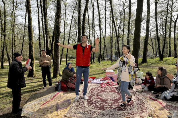 People dance and play music while enjoying the annual public picnic day on the 13th and last day of the Persian New Year, or Nowruz, holiday (Ebrahim Noroozi/AP)