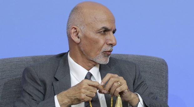 Ashraf Ghani received 50.64% of the vote (Paul Hackett/PA)