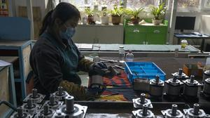China's economy rebounded from a painful contraction to grow by 3.2% over a year earlier in the latest quarter (Ng Han Guan/AP)