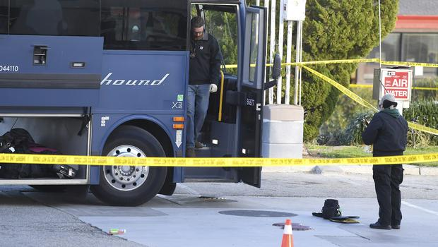 Investigators are seen outside a Greyhound bus after a passenger was killed on board in Lebec, California (Jayne Kamin-Oncea/AP)