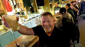 Marvin Radtke toasts the opening of the Friends and Neighbours bar following the Wisconsin Supreme Court's decision to strike down Governor Tony Evers' safer-at-home order amid the coronavirus pandemic (William Glasheen/AP)
