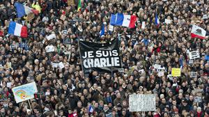 Thousands of people gather at Republique Square in Paris in the wake of the 2015 terror attacks against Charlie Hebdo (AP)
