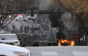 A vehicle on fire after the explosion (Andrew Nelles/The Tennessean/AP)