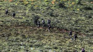 Members of search teams work at the site of a plane crash on a remote location in Van, eastern Turkey (Behcet Dalmaz/DHA via AP)