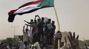 Sudanese protesters shout slogans as they march during a demonstration against the military council in Khartoum (Hussein Malla/AP)