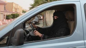 A woman drives a car in Riyadh, Saudi Arabia as part of a campaign to defy the nation's ban on women driving (AP)
