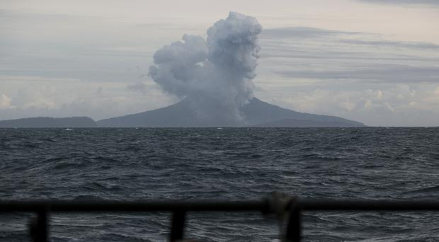 Anak Krakatau spewing volcanic material during the eruption (Fauzy Chaniago/AP)