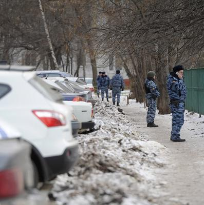 Special police officers stand guard in front a school in Moscow, Russia (AP)