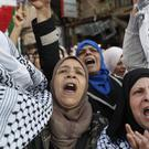 Palestinian women shouts slogans against Israel and US President Donald Trump during a protest against the White House plan for ending the Israeli-Palestinian conflict (Hussein Malla/AP)