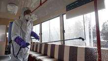 A worker sprays disinfectant in a tram carriage in Pyongyang, North Korea (Cha Song Ho/AP)