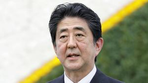 Shinzo Abe has promised to protect Japan from Guam-bound north Korean missiles (Kyodo News/AP)