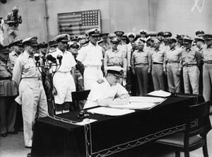 The Japanese surrender at Tokyo Bay with Admiral Bruce Fraser signing on behalf of the UK. Japan's current constitution was imposed after the Second World War. (Cross W G/PA)