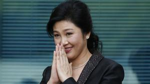 Yingluck Shinawatra is believed to have flown to Dubai to join her brother Thaksin (AP)