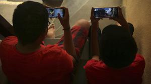Indian children play online game PUBG on their mobile phones in Hyderabad (Mahesh Kumar A/AP)