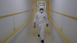 A member of the UME (Emergency Army Unit) wearing a protective suit to protect against coronavirus disinfects a nursing home in Madrid, Spain, Tuesday, March 31, 2020. The new coronavirus causes mild or moderate symptoms for most people, but for some, especially older adults and people with existing health problems, it can cause more severe illness or death. (AP Photo/Manu Fernandez)