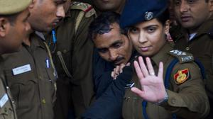 Shiv Kumar Yadav is escorted by police to a court in New Delhi, India. (AP)