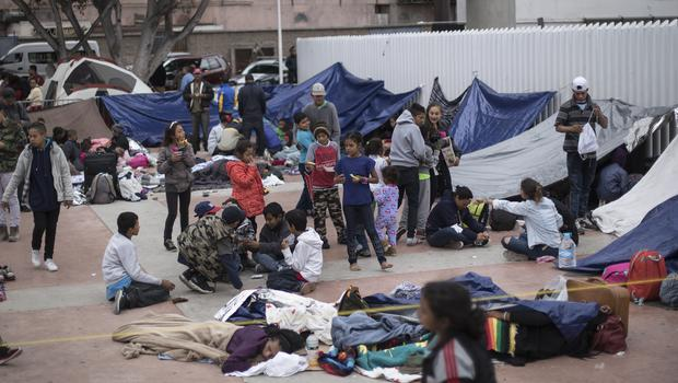 Migrants wait for access to request asylum in the US (AP Photo/Hans-Maximo Musielik)