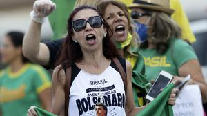 Demonstrators shout slogans against Brazil's Congress and Supreme Court during a protest demanding military intervention during the coronavirus crisis outside the National Congress in Brasilia on Monday (Eraldo Peres/AP)