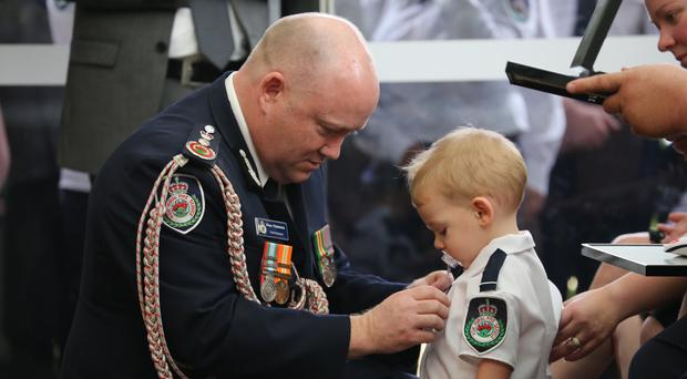 Undated handout photo from the Twitter feed of @NSWRFS showing Harvey Keaton, 19 months, who was presented, by NSW Fire Commissioner Shane Fitzsimmons, with his fatherÕs posthumous CommissionerÕs Commendations for Bravery and Service at the funeral of volunteer firefighter Geoffrey Keaton who died on December 19 2019 whilst on duty at the Green Wattle Creek fireground, Buxton. PA Photo. Issue date: Thursday January 2, 2020. See PA story AUSTRALIA Wildfires. Photo credit should read: NSW RFS/PA WireNOTE TO EDITORS: This handout photo may only be used in for editorial reporting purposes for the contemporaneous illustration of events, things or the people in the image or facts mentioned in the caption. Reuse of the picture may require further permission from the copyright holder.
