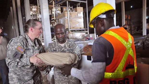 American soldiers sort through Ebola virus protection equipment to be used in clinics in Liberia (AP Photo/ Abbas Dulleh)