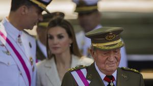 Then king Juan Carlos with his successor felipe in the background (Andres Kudacki/PA)
