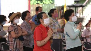 People wearing face masks to help protect against the spread of the coronavirus in South Korea (Ahn Young-joon/AP/PA)