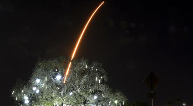 In a time exposure, the SpaceX Falcon 9 rocket launches from Cape Canaveral, Florida (Tim Shortt/Florida Today via AP)