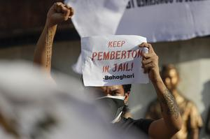 The pardon sparked anger in the former American colony (Aaron Favila/AP)