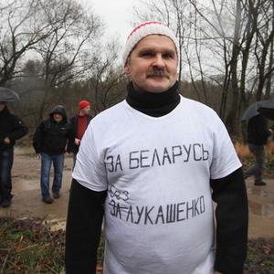 Belarus protester Leonid Smovzh wearing the T-shirt which got him jailed (AP)