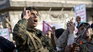A Houthi Shiite fighter chants slogans during a demonstration to show support for his comrades in Sanaa