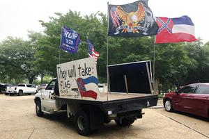 A utility vehicle driven by Mississippi man Joe Brister, calling for the retention of the state flag outside the state capitol building (Emily Wagster Pettus/AP)