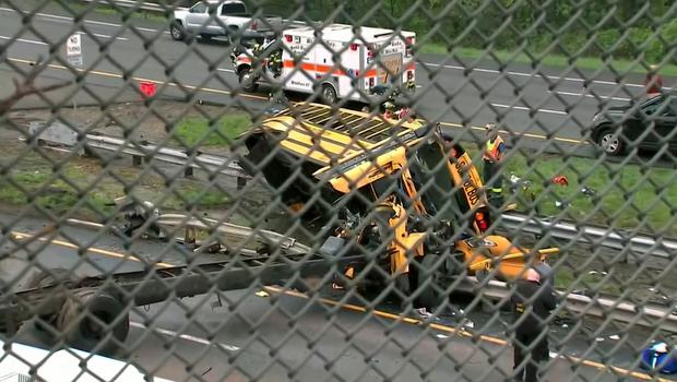 The overturned school bus after it collided with a truck (WABC-TV via AP)