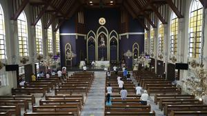 Catholic parishioners keep their distance at a mass in Quezon City on Sunday (Aaron Favila/AP)