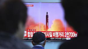 People watch a TV screen showing a file footage of a North Korean missile launch, at Seoul railway station (AP Photo/Ahn Young-joon)