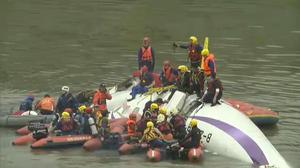 A a commercial plane lies in the river after crashing in Taipei shortly after takeoff (AP)
