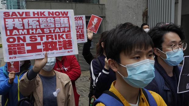 Medical staff strike over coronavirus concerns outside government headquarters in Hong Kong (Vincent Yu/AP)