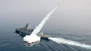 A South Korean navy ship fires a missile during a drill in the East Sea (South Korea Defence Ministry/AP)