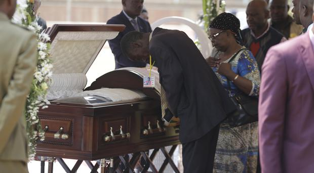 Mourners pay their last respects at the coffin of former Zimbabwean President Robert Mugabe (Themba Hadebe/AP)
