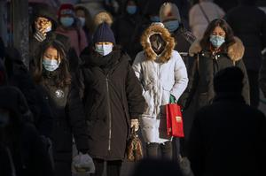 People wearing face masks in Beijing (AP/Mark Schiefelbein)