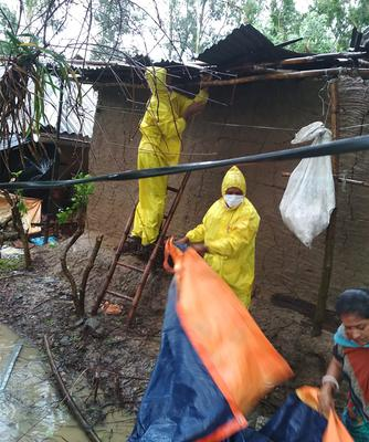 Volunteers repair the homes of villagers after Cyclone Amphan hit India (Indian Red Cross Society via AP)
