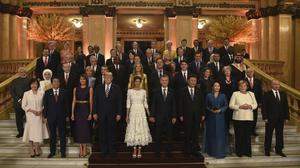 Leaders and their partners pose for a group photo at the G20 Summit (G20/AP)