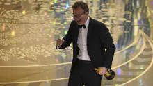 A beaming Tom McCarthy walks on stage to accept the best picture award for Spotlight (Invision/AP)