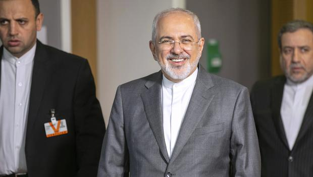 Iranian Foreign Minister Javad Zarif leaves after a meeting with European Union foreign policy chief Federica Mogherini at the Europa building in Brussels (Olivier Matthys/AP)