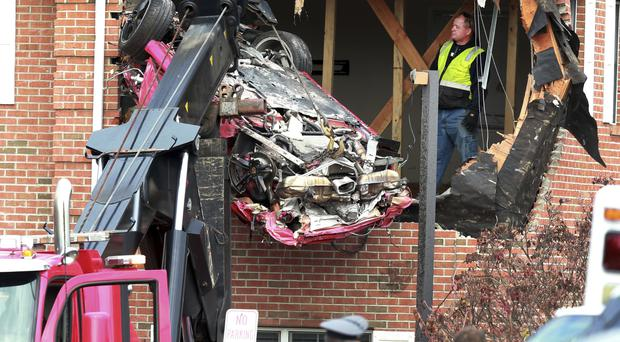 Two people were killed after a Porsche they were travelling in hit a building in New Jersey (NJ Advance Media/AP/PA)